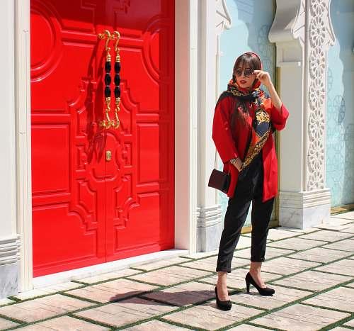 person woman standing near door apparel