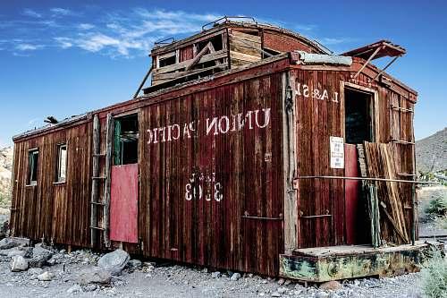 railroad brown containerized housing unit train