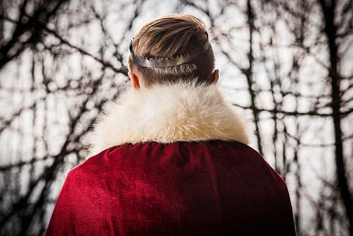 fur person wearing red and white coat trees