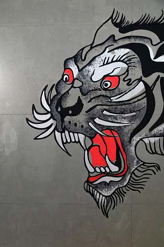 text gray, black, and white tiger art on wall graffiti