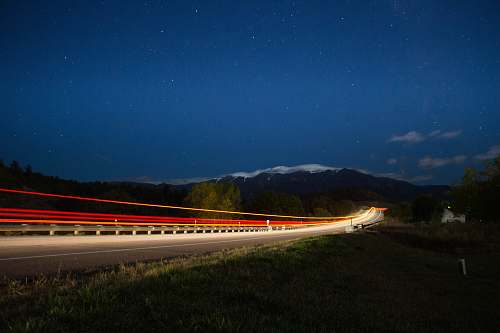 rye time lapse photograph of train under starry sky united states