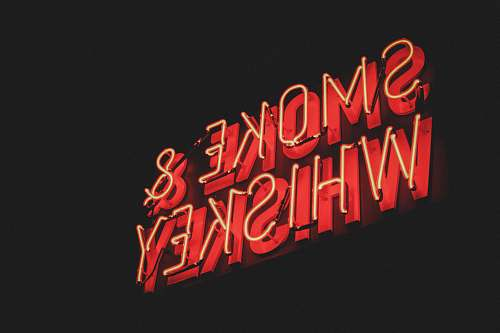 neon yellow and red Smoke & Whiskey LED signage dynamite