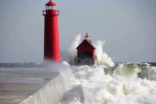 beacon red lighthouse near sea coast