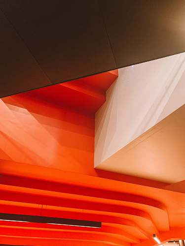 banister orange and white painted building interior handrail