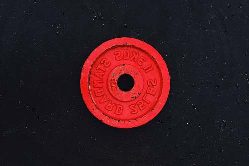symbol 11.3 kgs red barbell plate trademark