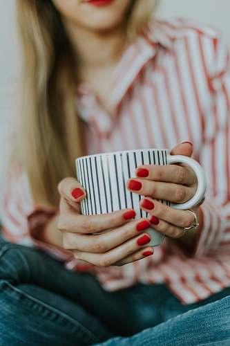 riga selective focus photo of a woman holding a white coffee mug latvia