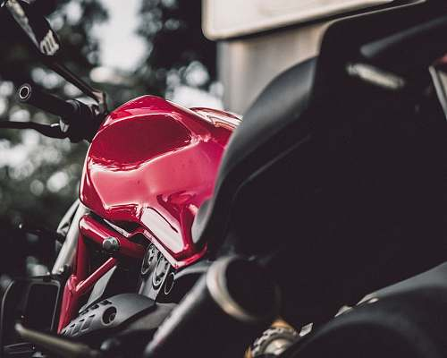 transportation red and black sports bike during day vehicle