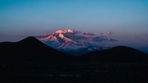 ridge aerial photo of mountains during daytime mountain range
