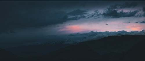 sky landscape photography of mountains during nighttime clouds