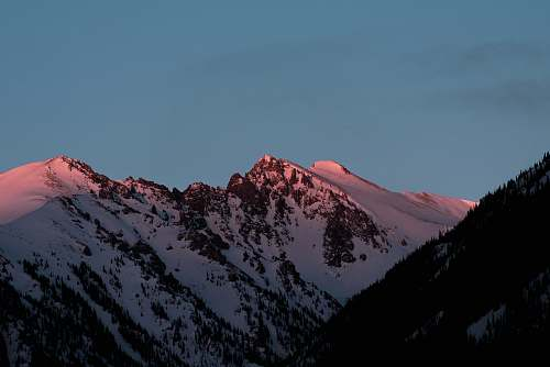 outdoors mountain covered in snow at golden hour mountain range