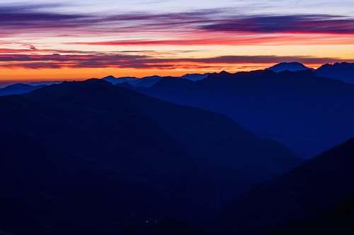 sunset mountain ranges under orange sky during sunset sunrise