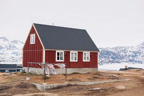 building photo of red and black house tasiilaq