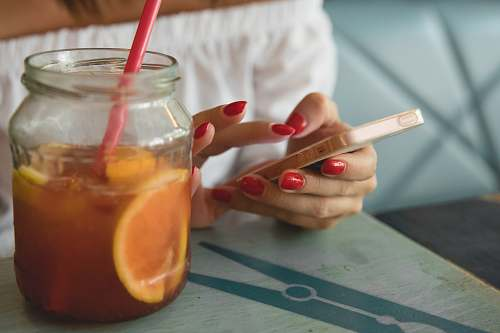 manicure clear glass jar filled with fruit juice drink