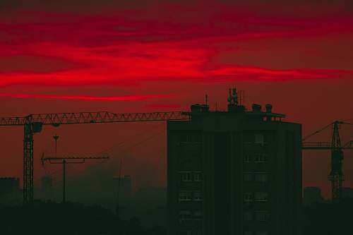 outdoors brown building under red clouds dawn