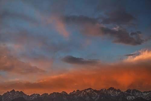 sunset gray mountain range during sunset sky