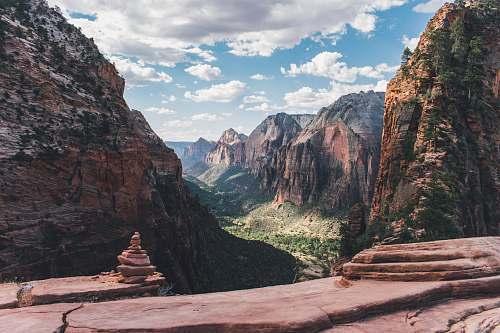 mountain national park mountain range during daytime canyon