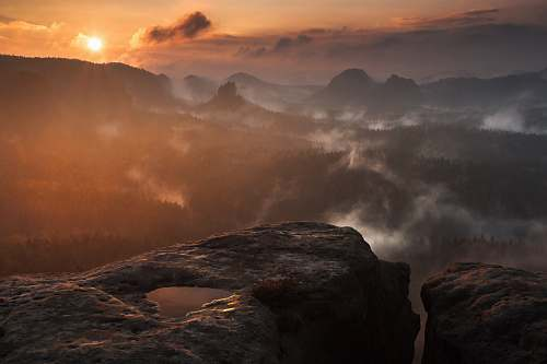 dawn photograph of mountains surrounded by mist mountain