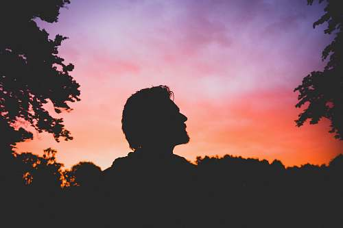 sunset silhouette of man during sunset silhouette