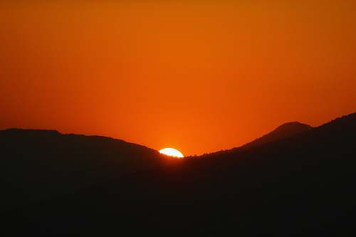 outdoors silhouette of mountains during golden hour dawn