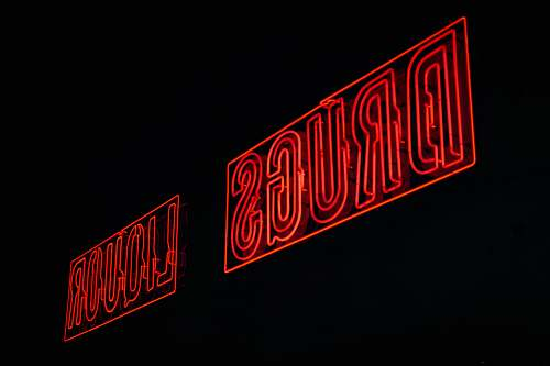 light red drugs liquor neon signages red