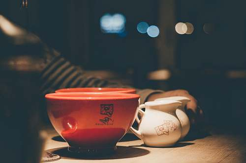 le pain quotidien selective focus photography of two red ceramic bowls near two white ceramic pitchers united states