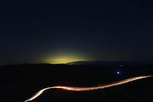 light time lapse photography of road at night time road