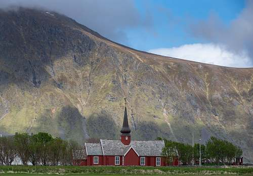 lofoten red and gray house under green mountain at daytime nature