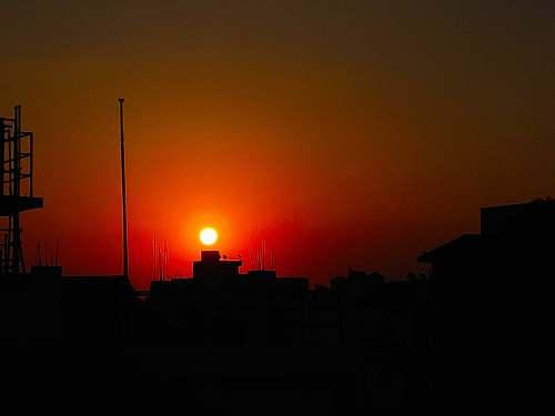 sunlight building silhouette at dawn dawn