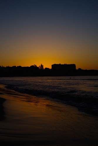 dawn seashore during golden hour dusk