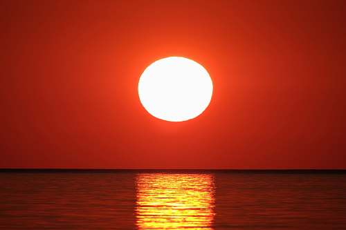 nature sunset over body of water sun