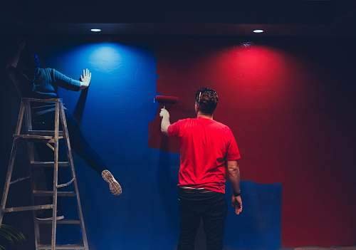 human man and woman painting wall person