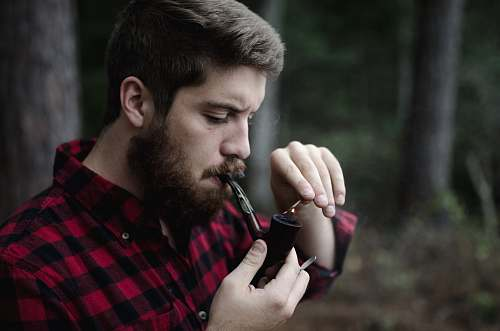 person man smoking smoking pipe human