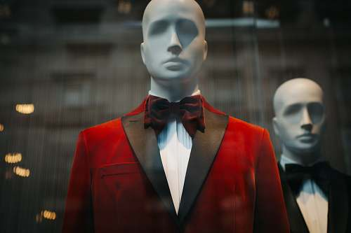 person mannequin wearing red notched lapel suit jacket human