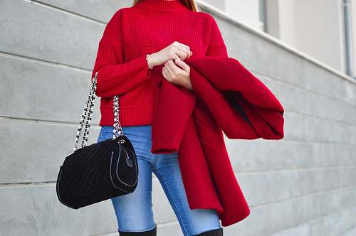 human woman in red sweater beside white wall person