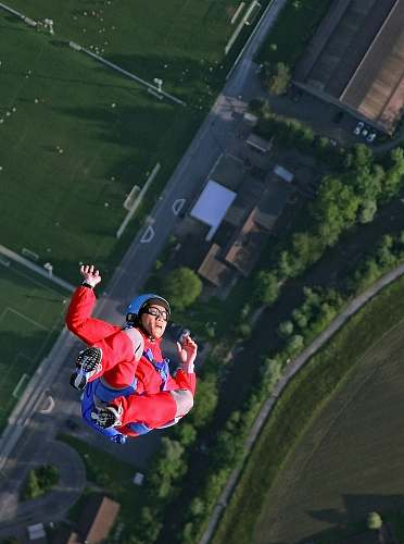 person woman on flip position sky diving human