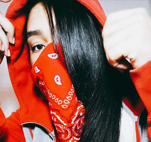 human woman wearing red and white paisley scarf taking close-up selfie person