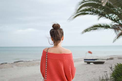 photo person woman wearing red knitted sweater standing on the beach human free for commercial use images