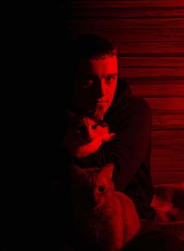 human man hugging white cat animal