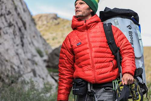 man man looking above carrying gray camping backpack male
