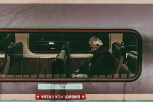 transportation man sitting on train seat human