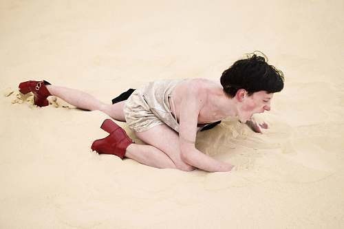 human person crawling on sand people