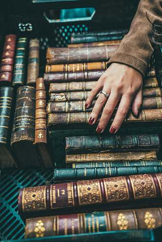 human person hand on group of books book