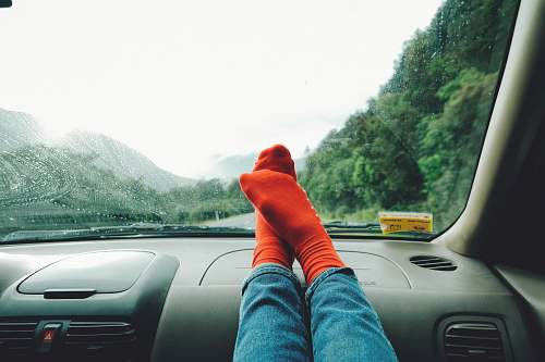 car person wearing red socks near mountain vehicle