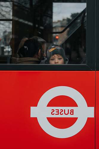 human photo of child riding in bus people