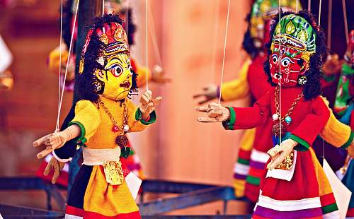 people selective focus photography of deity marionettes human