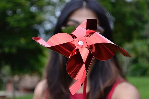 human selective focus photography of red paper mill people