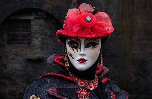 performer shallow focus photography of person in masquerade mask human