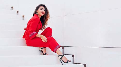 apparel smiling woman sits on stairway clothing