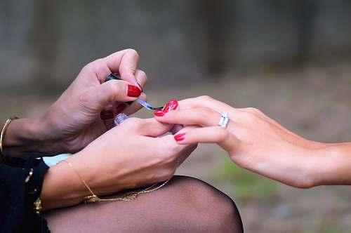 human woman doing manicure people