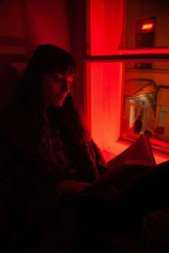 light woman sitting near window human